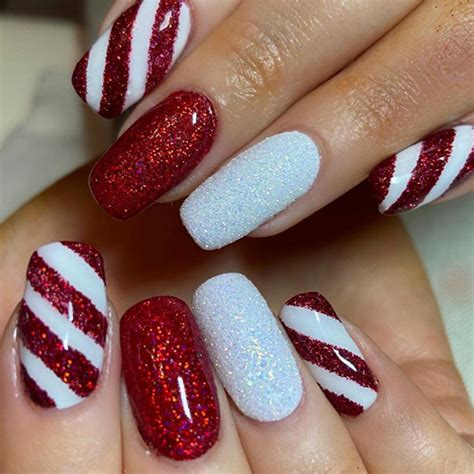 Winter nails 2020, gel painting nail art, cartoon characters nail art, penguin nail art knitted. Best Christmas Nails - 25 Best Christmas Nails for 2020 - FavNailArt.com