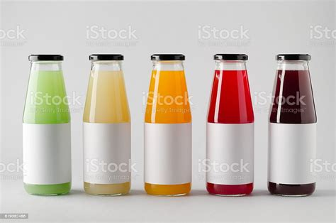 Download this bottle mockup design for juices designs presentation. Juice Bottle Mockup Multiple Bottles Blank Label Stock ...