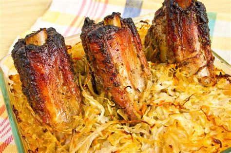 spare ribs baked  sauerkraut stock photo image
