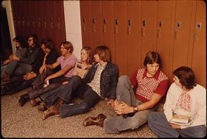 File:STUDENTS RESTING IN THE HALL AGAINST THEIR LOCKERS ...