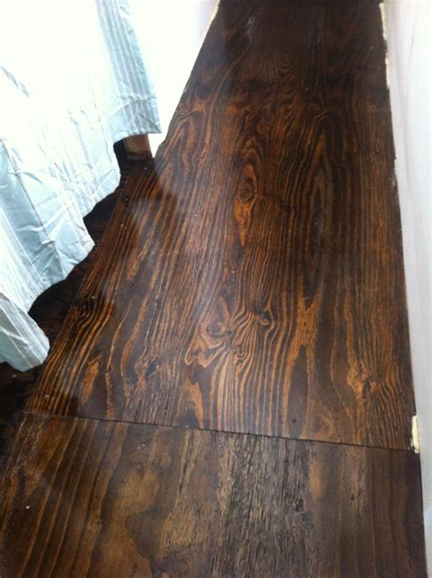 Stained plywood floor! We remodeled an old trailer house