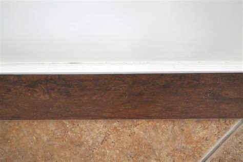 faux wood laminate flooring our flooring solid wood vs faux wood tile chris loves julia