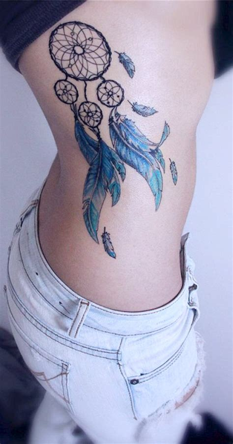 traditional watercolor dreamcatcher side rib tattoo ideas