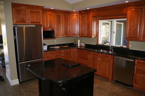 gallery for gt black countertops with cherry cabinets