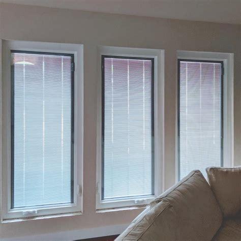 mi  vinyl casement window  slate gray blinds   glass