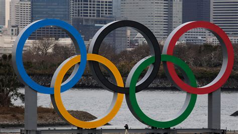 PHOTOS: Olympic rings arrive in host city on barge into ...
