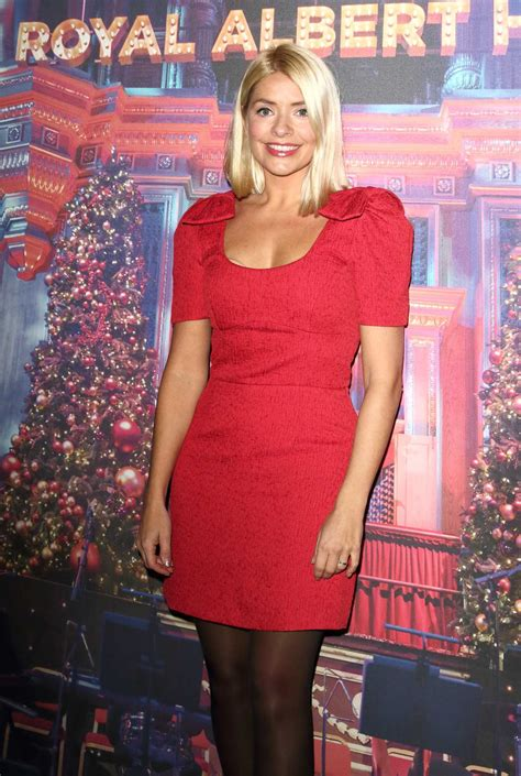 holly willoughby   red dress attends emma bunton christmas party  royal albert hall