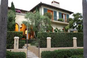 decorative canisters kitchen wrought iron fence designs exterior mediterranean with arched windows arches balcony