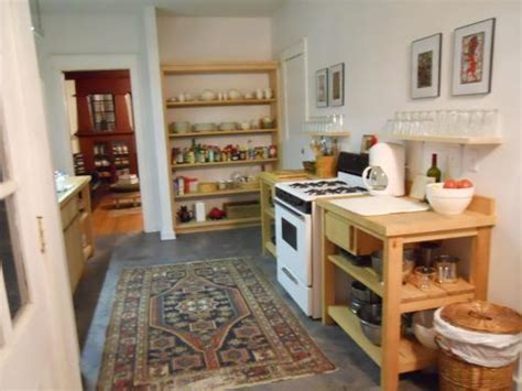 A Kitchen Without Traditional Cabinetsthought?  Not