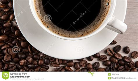 Check out their videos, sign up to chat, and join their community. White Cup Of Coffee Against A Background Of Fried Coffee Beans Stock Photo - Image of kitchen ...