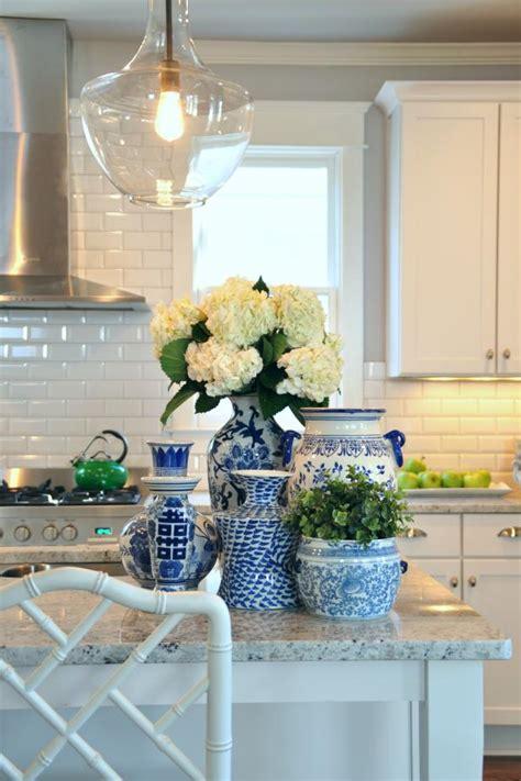 white kitchen  flowers   decorated island hgtv