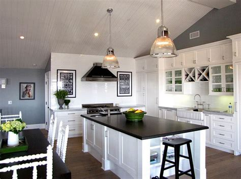 white kitchen dark counters black and white kitchens ideas photos inspirations 304 | Wall art in black and white accentuates the color scheme