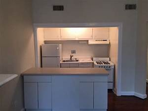 How To  Reface Kitchen Cabinets Using Vinyl Flooring