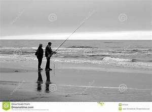 People fishing on beach stock photo. Image of grey ...