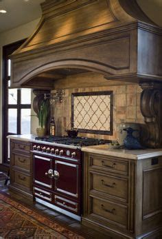paintable kitchen cabinets surrounds gas cooking stove in this traditional 1376