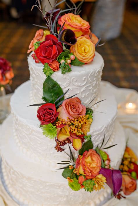 tier wedding cake decorative piping  autumnal flowers