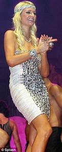 Paris Hilton dances up a storm among the scantily clad men ...