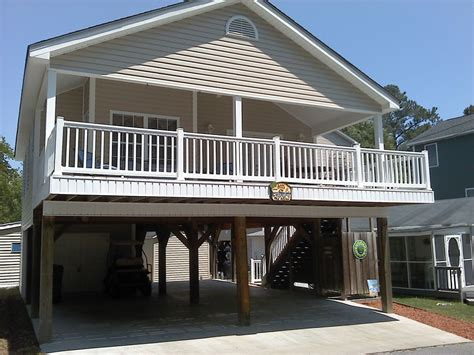 harmonious house on stilts designs raised house with golf cart great rates for vrbo