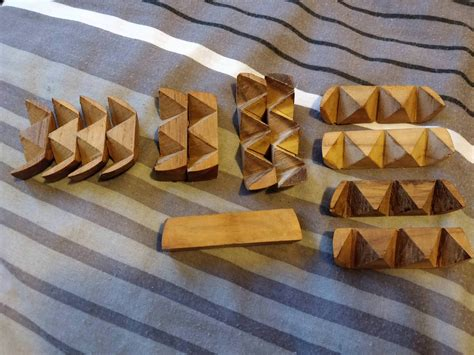 Help with 13 piece wooden oval puzzle : mechanicalpuzzles