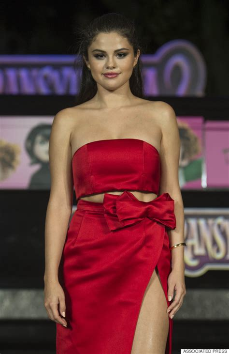 selena gomez  red hot   thigh high slit dress huffpost
