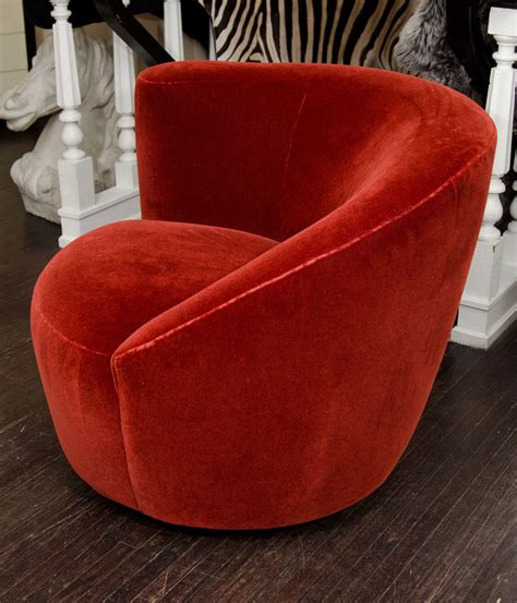 pair of 1970 s vladamir kagen swivel chairs upholstered in