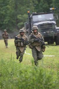 Stock Photo of Soldiers Running Ahead of a Military Truck ...
