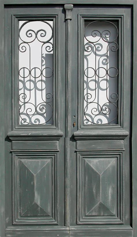 double leaf glazed entrance door willforged iron front