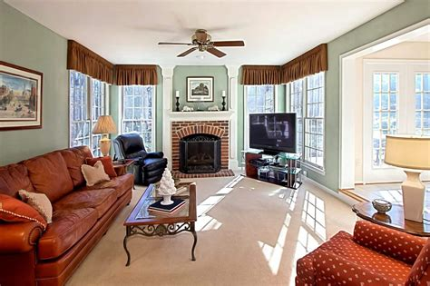 rooms with red brick fireplaces open foyer impresses in