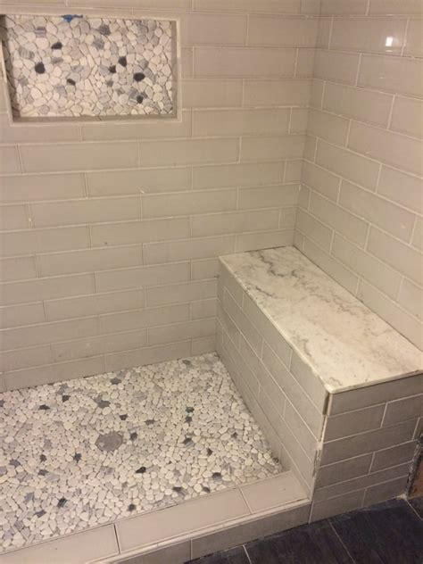 shower with 4x16 ceranic glass tile walls 12x12 templates