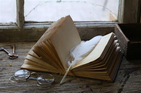 vintage book  window sill sunglasses keys feather hd