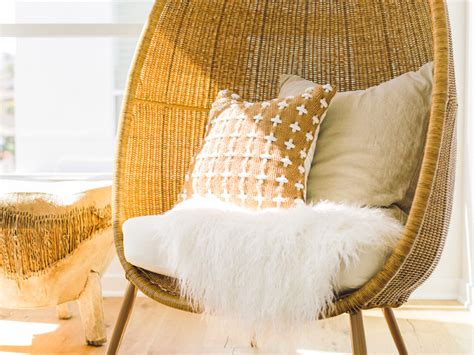 modern egg shaped wicker chair with sheepskin midcentury
