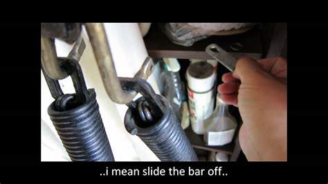 replacing garage side extension spring     piece garage door youtube