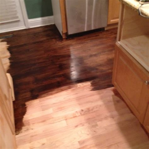 applying minwax polyurethane to hardwood floors applying minwax jacobean stain to sanded floor in kitchen