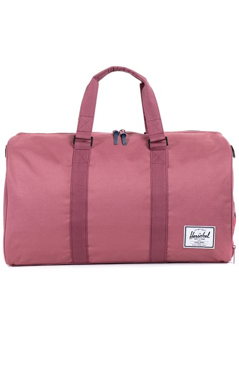 leather weekender bag with shoe compartment lyst herschel supply co the novel duffle bag in pink