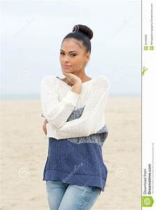 Beautiful Young Woman Standing Alone On Beach Stock Photo ...