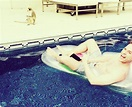 Olly Murs is joined by a friend as he relaxes on a lilo ...