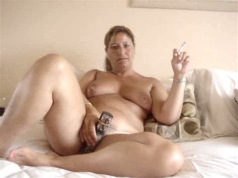 Mature And Chubby Woman Masturbating And Smoking On Cam
