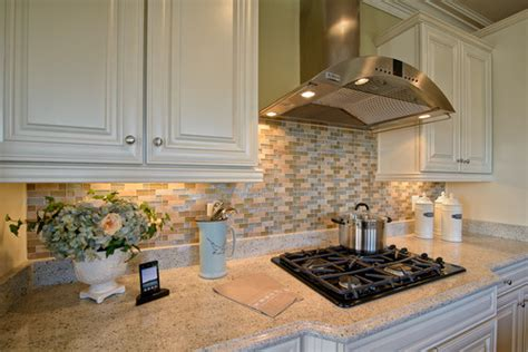 there is a 4 inch granite lift backsplash then the tile