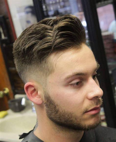 fade haircuts  black men hairstyle mid fade haircut  fade haircut  fade haircut