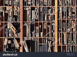 a box of old vintage printing press letter blocks in a old With old printing press letters
