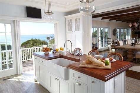 White Island With Wood Countertop In Beach House Kitchen