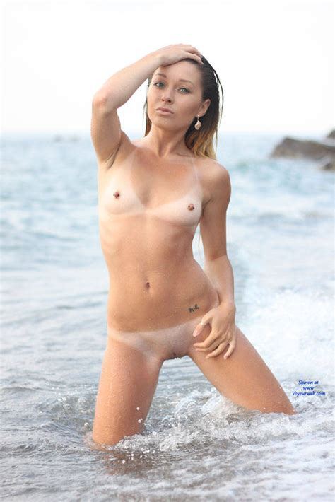 Kneeling And Naked At The Beach Water February