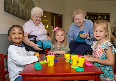 intergenerational preschool northpointe christian schools 354 | Cropped 8179 5 around table smiling