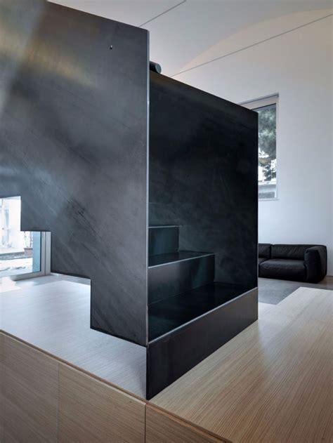 buratti architetti  massive black metal staircase fit
