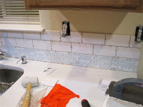 installing mosaic backsplash in kitchen installing a mosaic and subway tile kitchen backsplash 7555