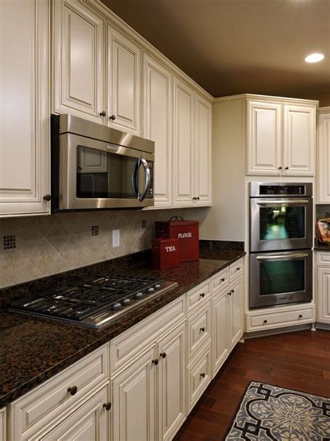 brown kitchen cabinets with white countertops baltic brown granite counters with white cabinets 156 | 505d614823784cbb49bb93875253ec37
