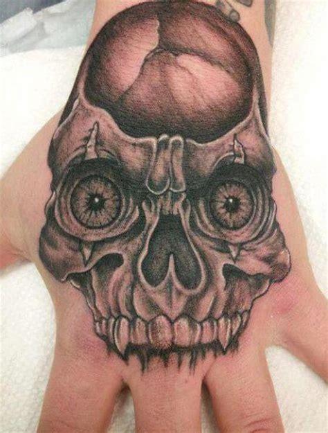 totenkopf hand masken tattoo von eternal ink tattoo
