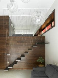 Invisible Doors Turn A Modern Home Into An Artistic Feat Of Design by Staircase Screen Patterns And Designs Exploring Design