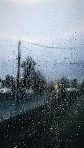 on window rainy day in traffic blue gray