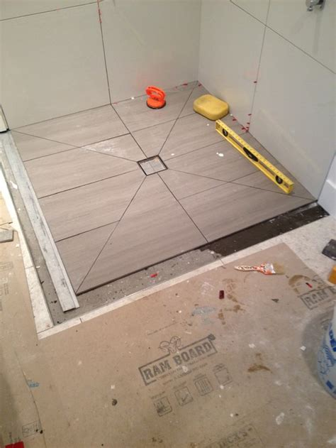how to tile a shower floor using diagonal cuts to slope your shower floor planning